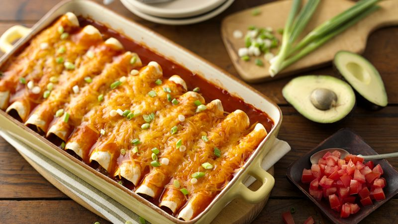 Enchiladas with beef in casserole baking dish.