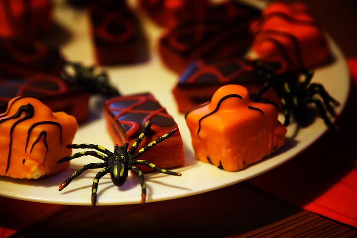 Pinterest graphic with text and Halloween treats on white plate.
