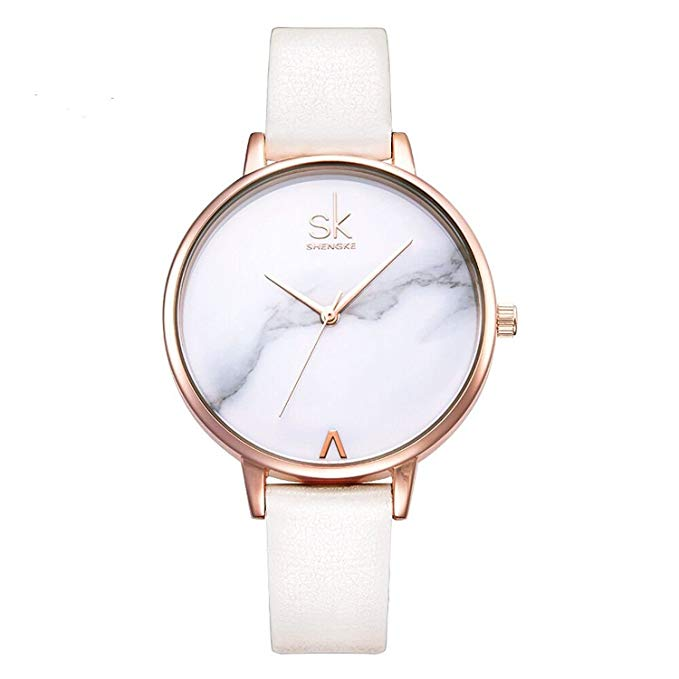 Rose gold and marble women\'s watch.
