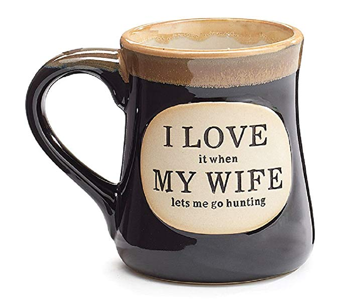 """Men\'s mug that says \""""I love it when my wife lets me go hunting\""""."""