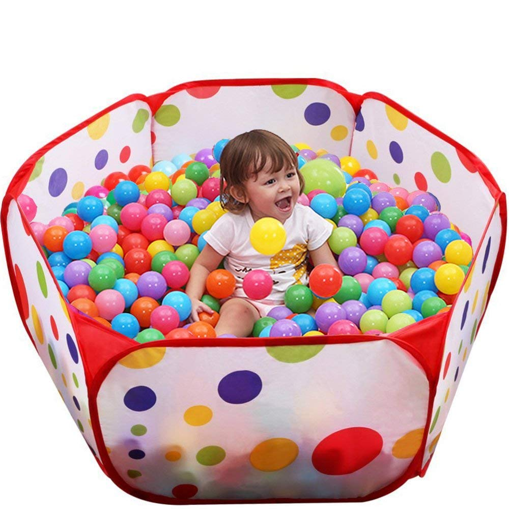 Toddler plays in ball pit play pin.
