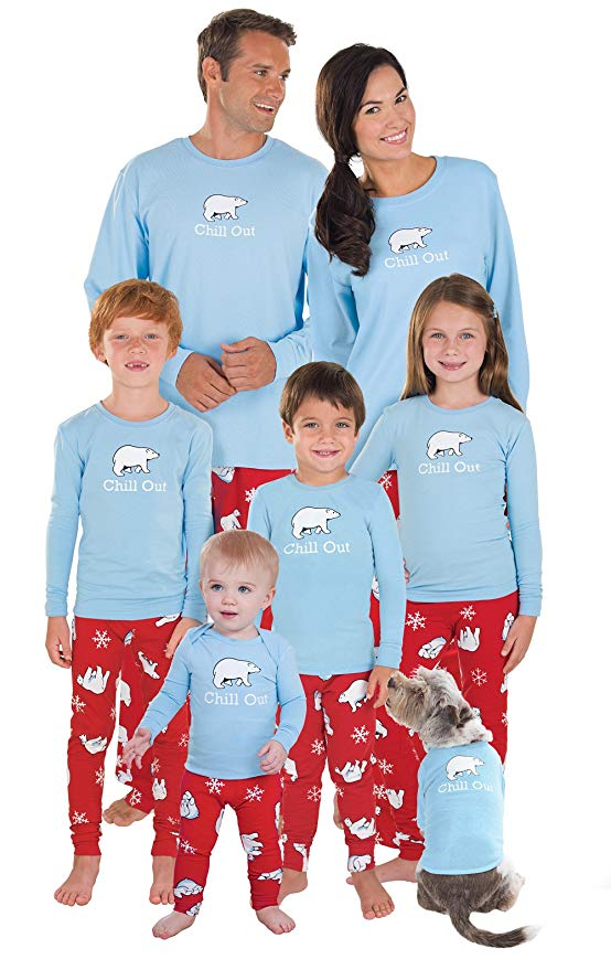 Parents and children wear matching sleep clothes with blue polar bear tops and red bottoms.