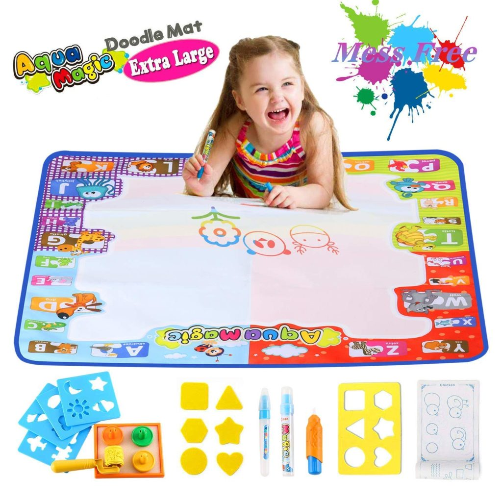 Little girl plays on Magic Doodle Mat.