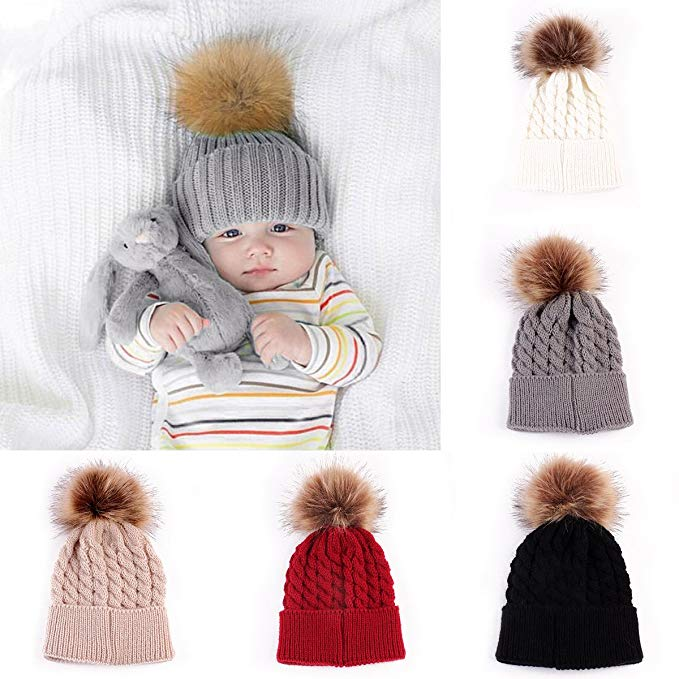 Assortment of knit hats for babies.