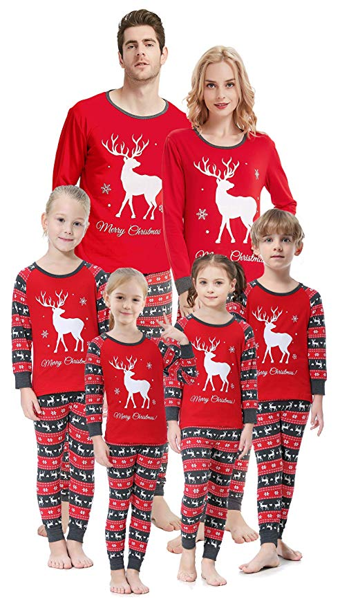 Family wears red and blue pajamas with reindeer.