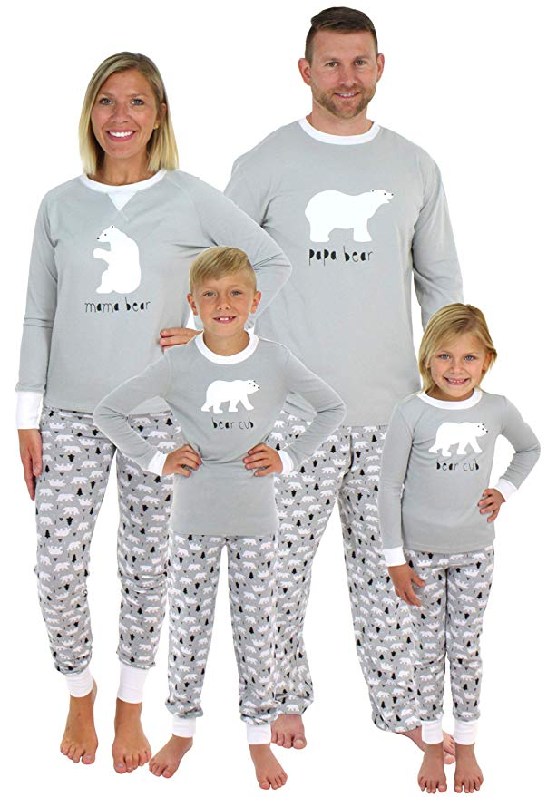 Family in gray and white pajama sets with polar bear design.