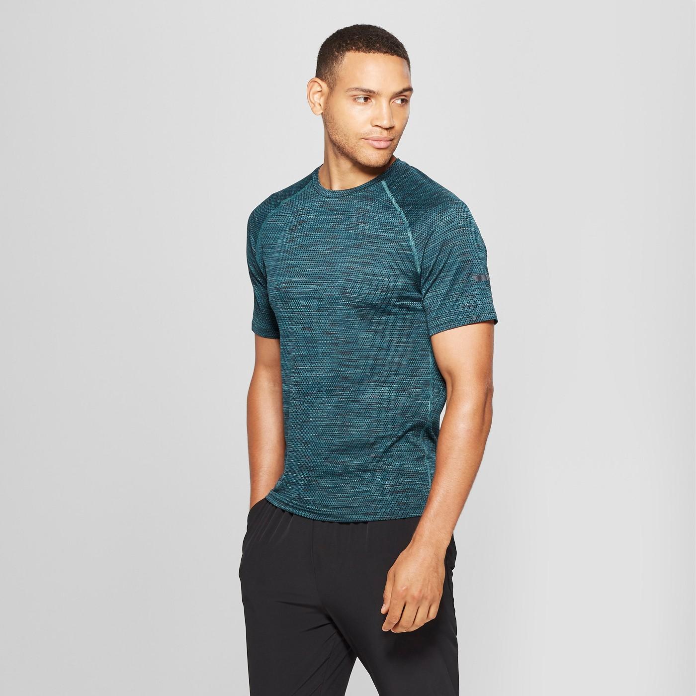 Man models green compression shirt.