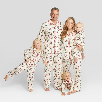 Family wears matching PJ set.
