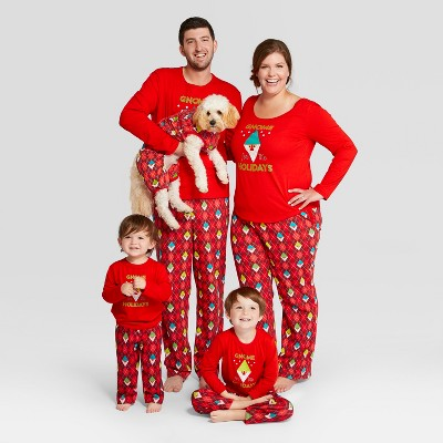Family in matching sleep clothes for Christmas.
