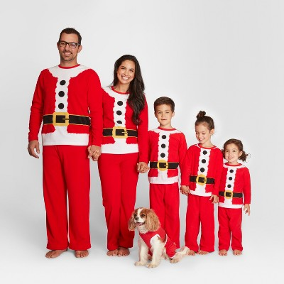 Family wearing Santa suite PJs for the holidays.