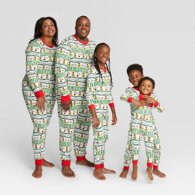 Family wears green, white and red PJ sets for Christmas.