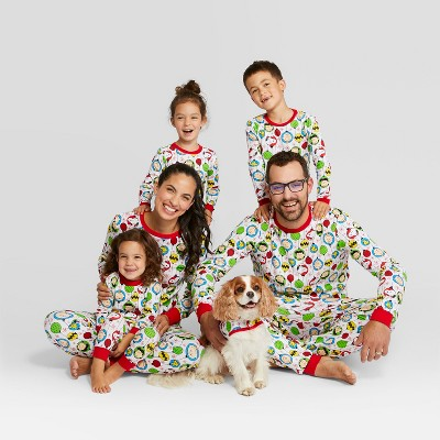 Family models green white and red pajamas for the holidays.