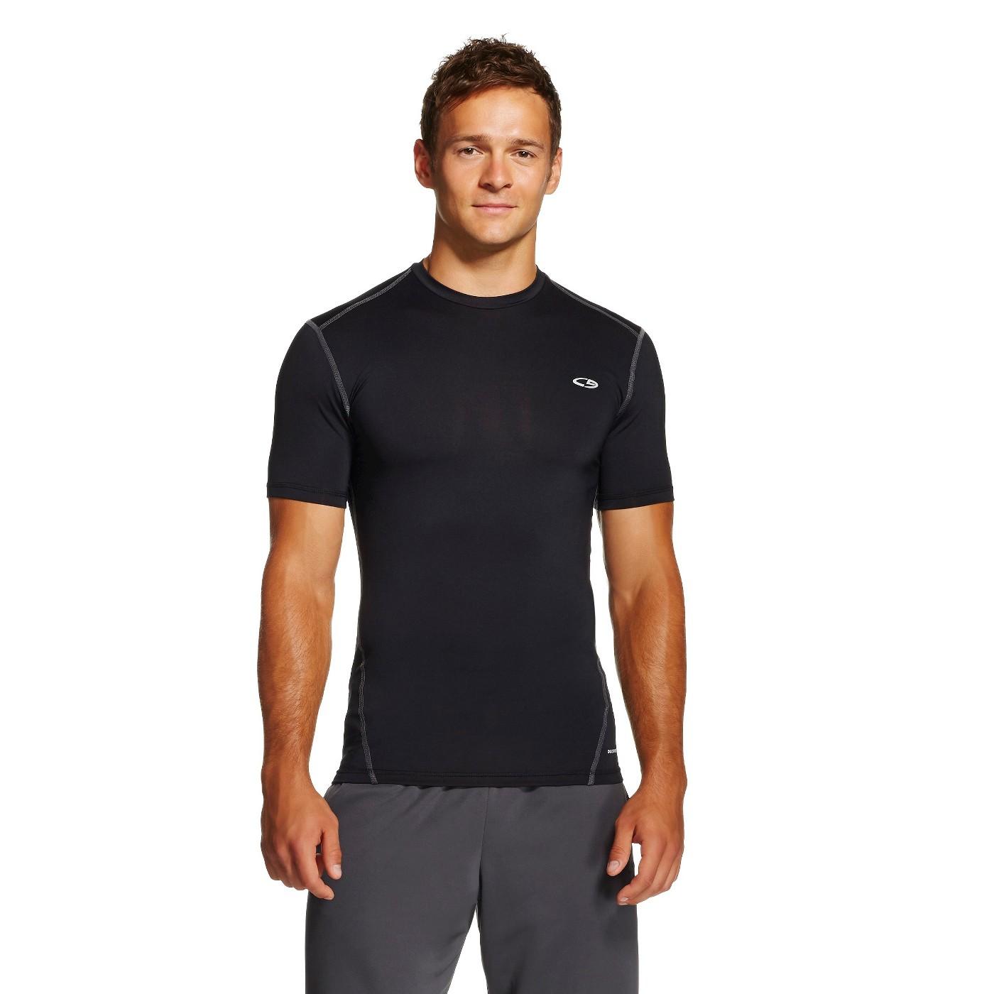 Man models black compression shirt.