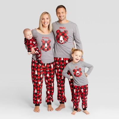Family wars matching holiday themed pajamas.