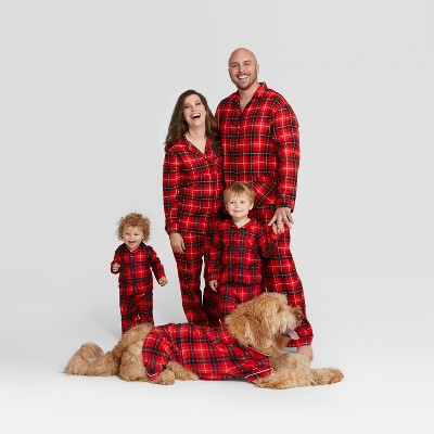 Family models matching black and red checkered Christmas PJs.