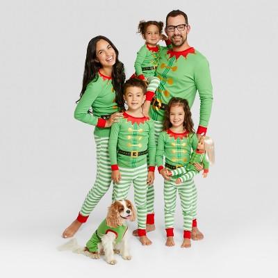 Family wears Elf pajamas for the Christmas Holiday.