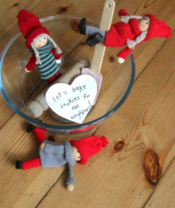 Kindness elves in glass cup.