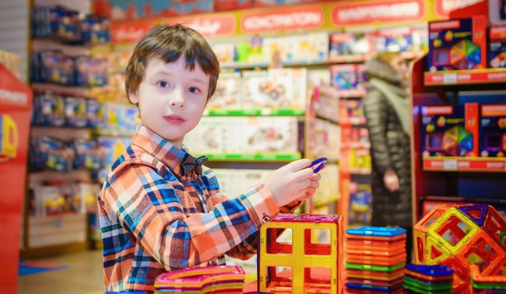 Child picks toys to donate for Christmas.