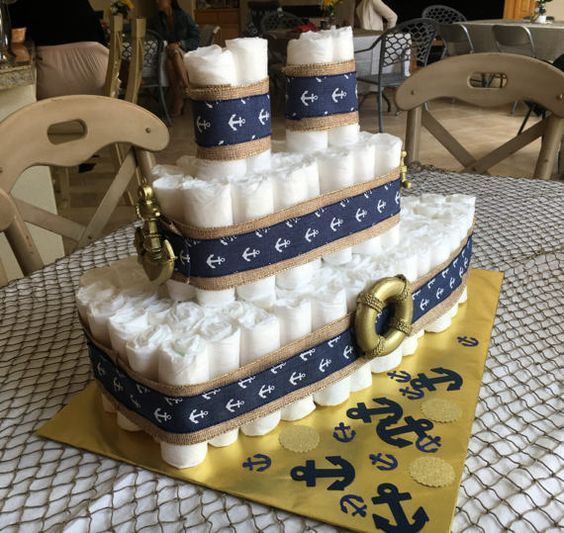Faux cake in shape of ship for boy baby shower.