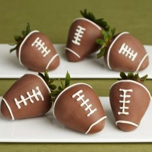 Football chocolate dipped strawberries.