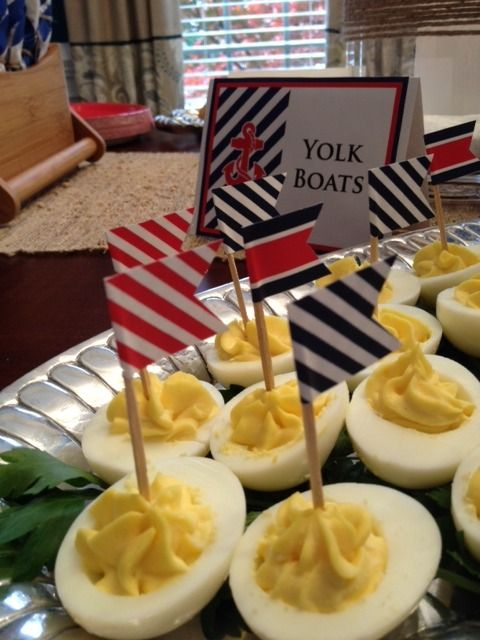"""Deviled egg \""""boats\"""" with mini flags."""