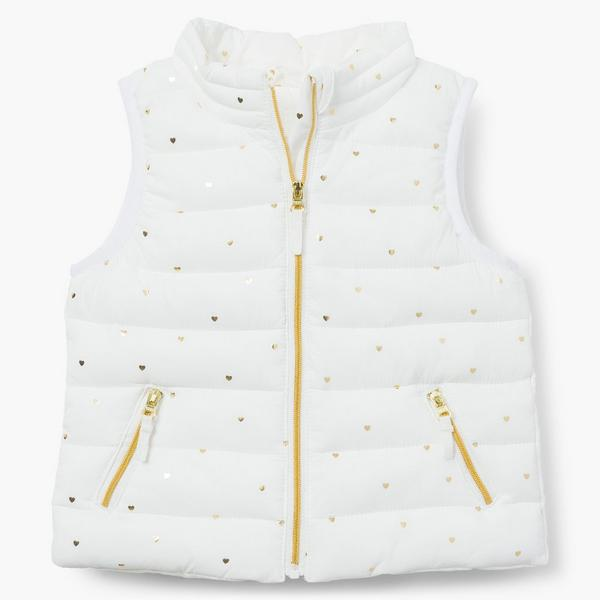 White puffer vest with gold zippers.