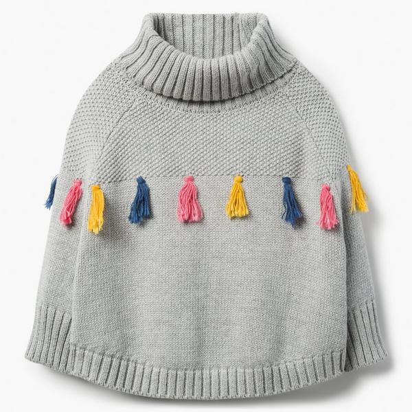 Gray, knit poncho with multi-colored tassels.