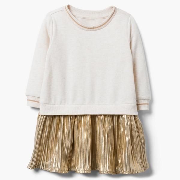 Gold and white sweater and skirt set.