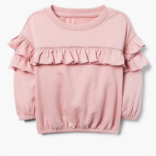 Girly pink long sleeved shirt with ruffles.