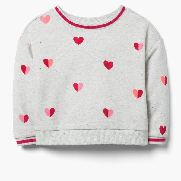 Light gray sweater with pink and red hearts.
