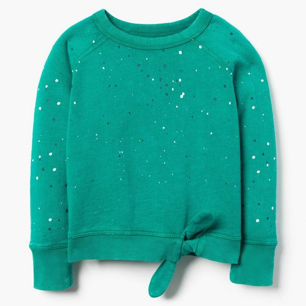 Green sweater with glitter for little girl.
