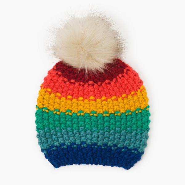 Rainbow beanie with fur pouf.