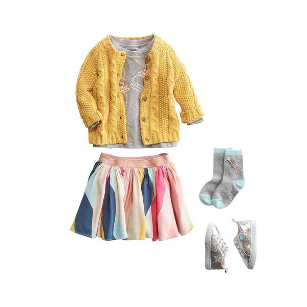 5 piece little girl outfit with top, sweater, skirt, socks and shoes.