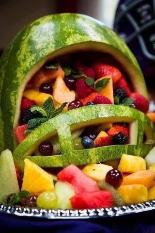 Watermelon football helmet with fruit.