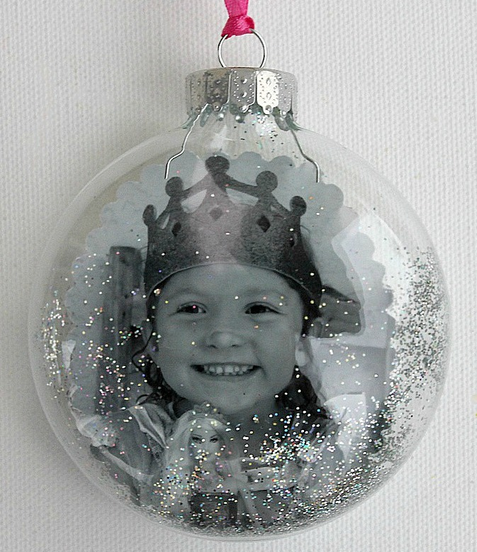 Black and white pictures of little girl inside clear Christmas ornament.