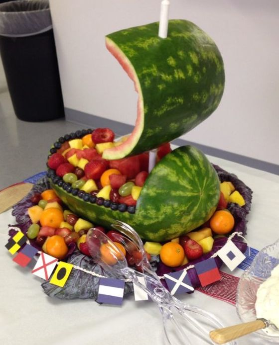 """Watermelon \""""boat\"""" with various fruit."""