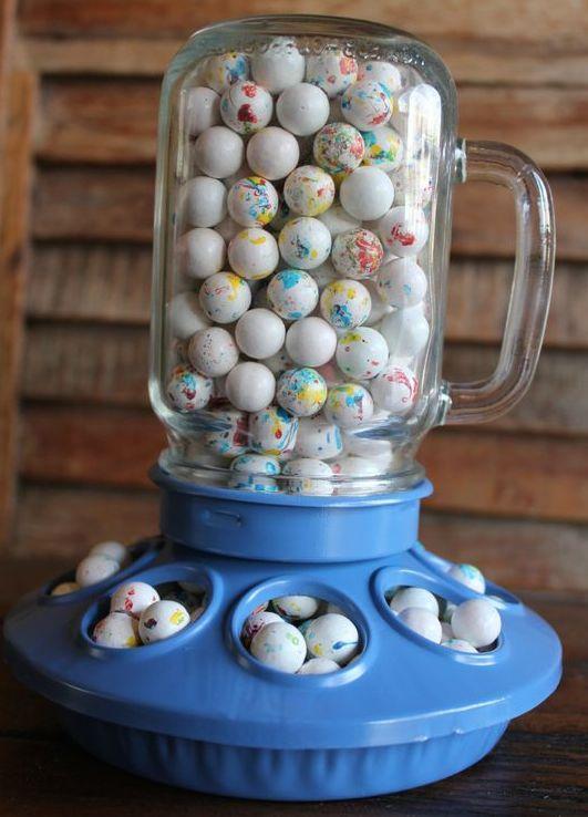 Bird feeder with mini chocolate eggs for farm baby shower.