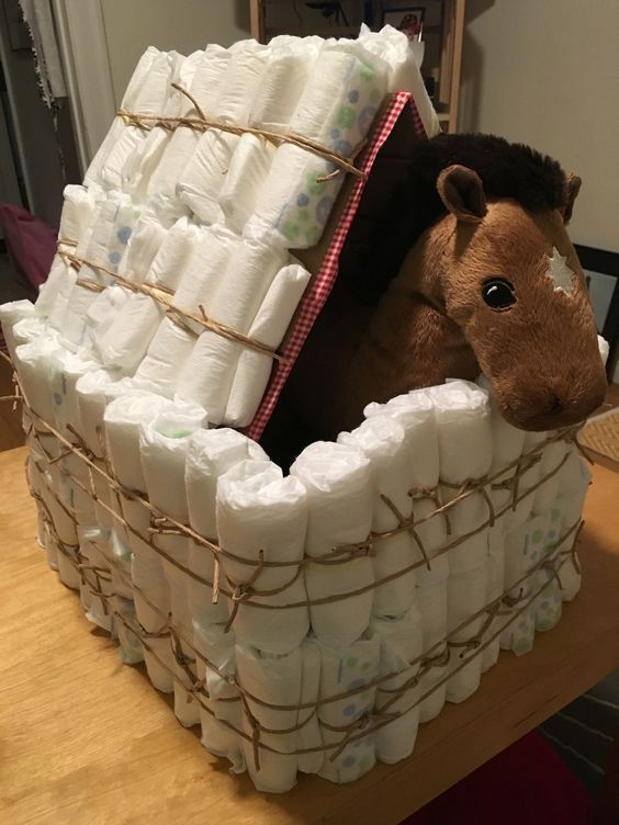 Diaper horse stall and stuffed animal horse.
