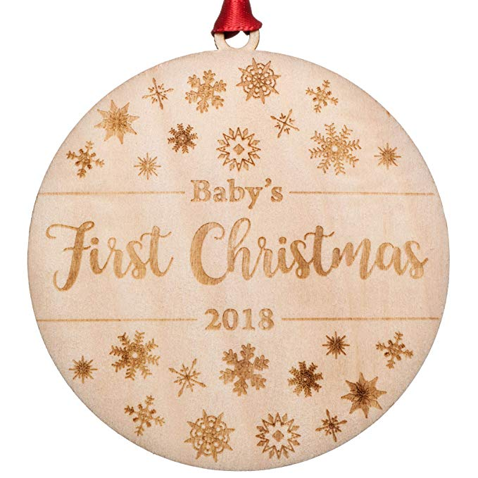 Christmas ornament with snowflake detail and year.