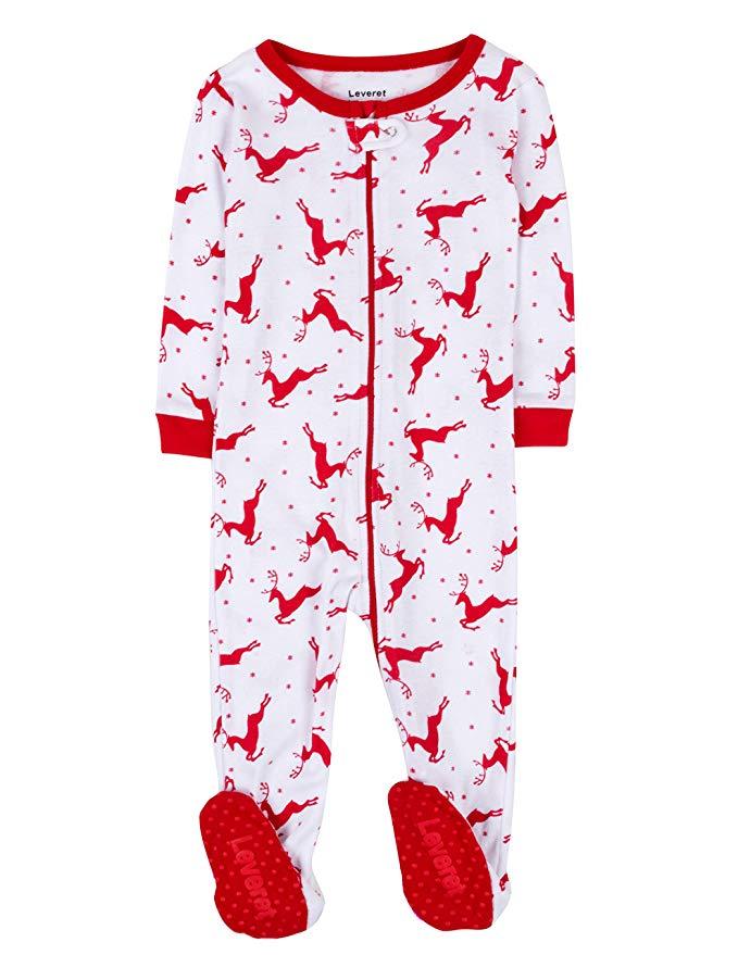 White and red reindeer print baby pajamas.