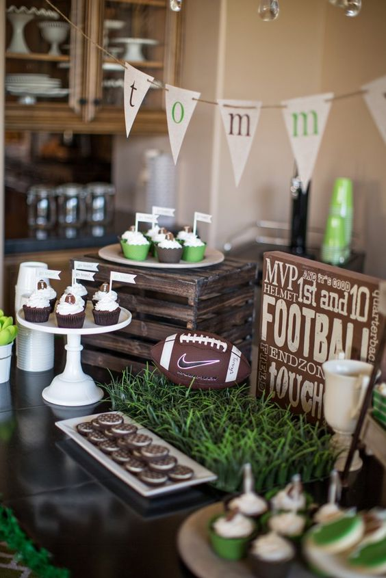 Green and brown football baby shower decorations.