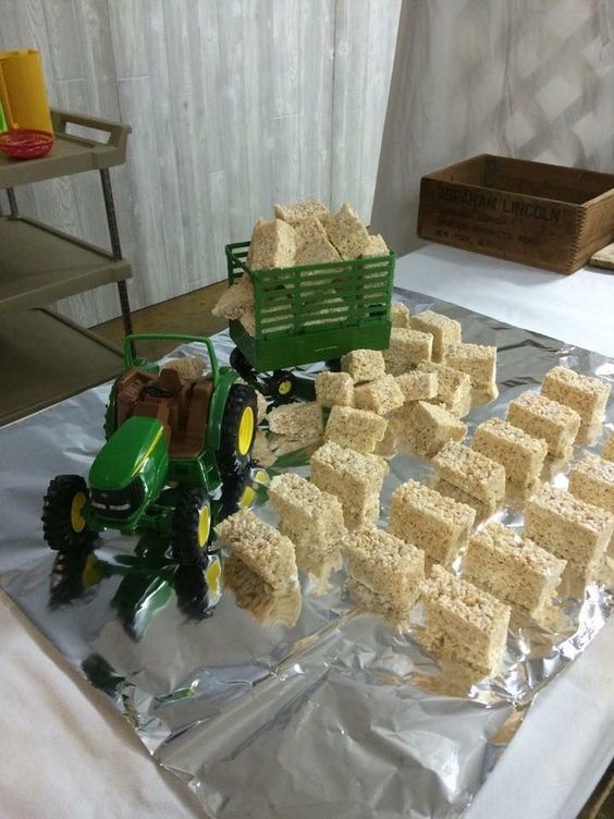 Rice Krispie treat hay bales and toy tractor for farm baby shower.