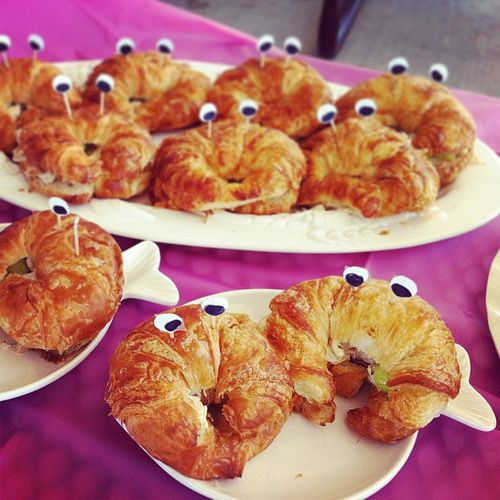 Crescent sandwiches with google eyes to make crab for themed baby shower.