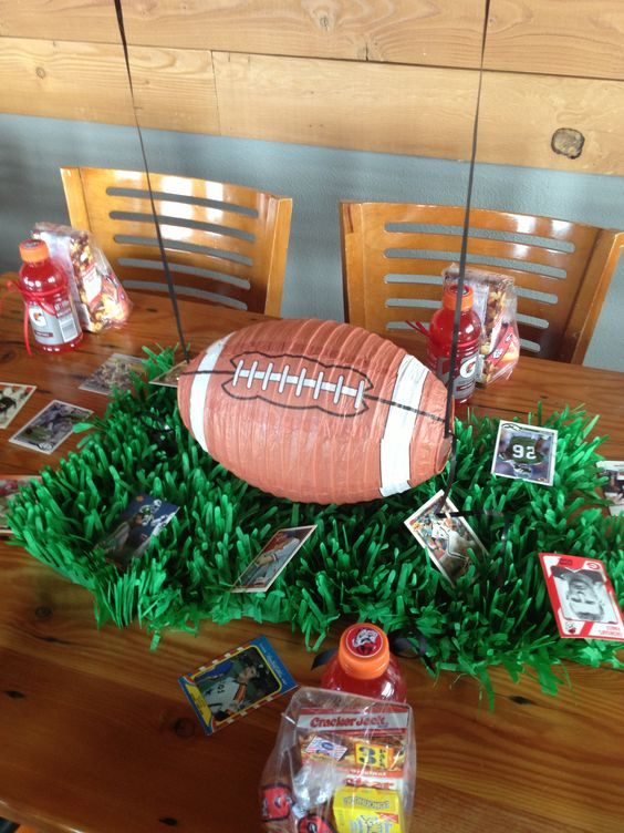 Football and faux grass centerpieces for boy shower.