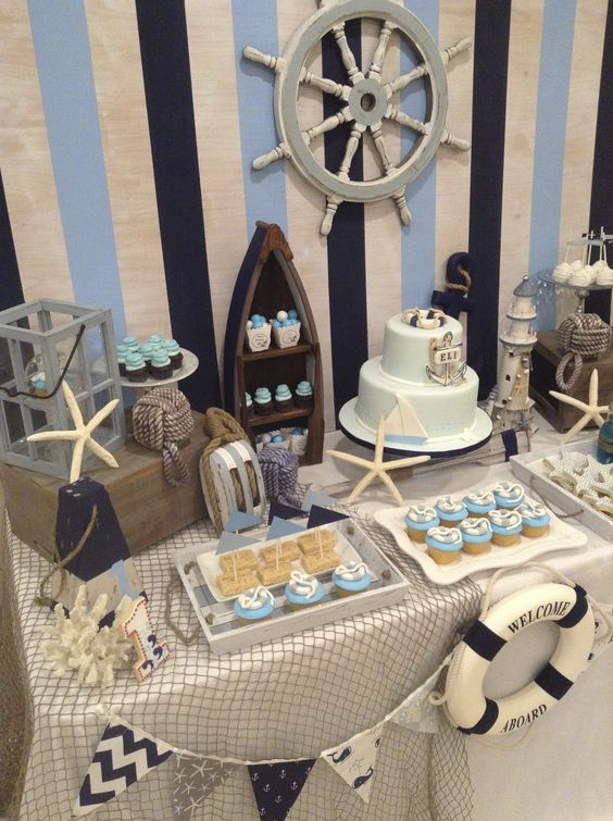 Nautical tablescape and backdrop for boy baby shower.