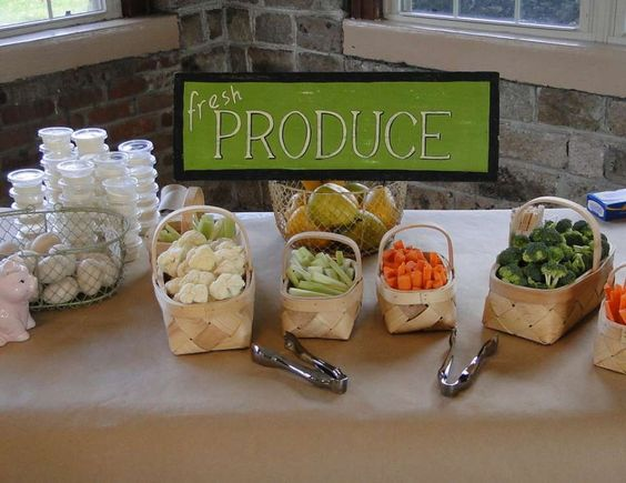 Fresh produce sign with mini baskets of veggies for baby shower.