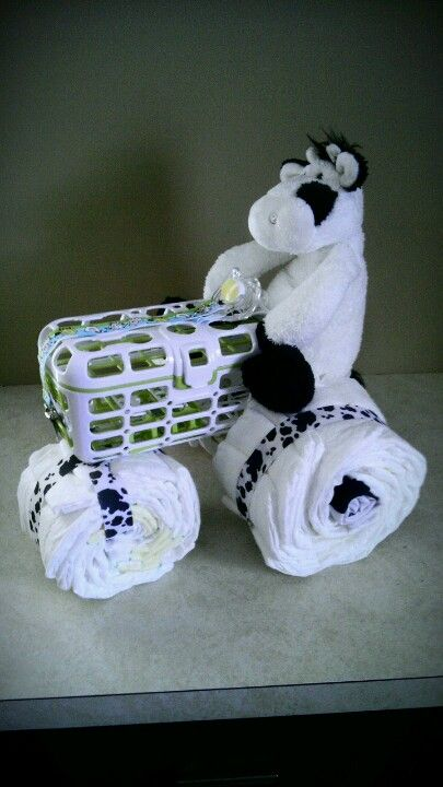 Baby items shaped to form tractor.