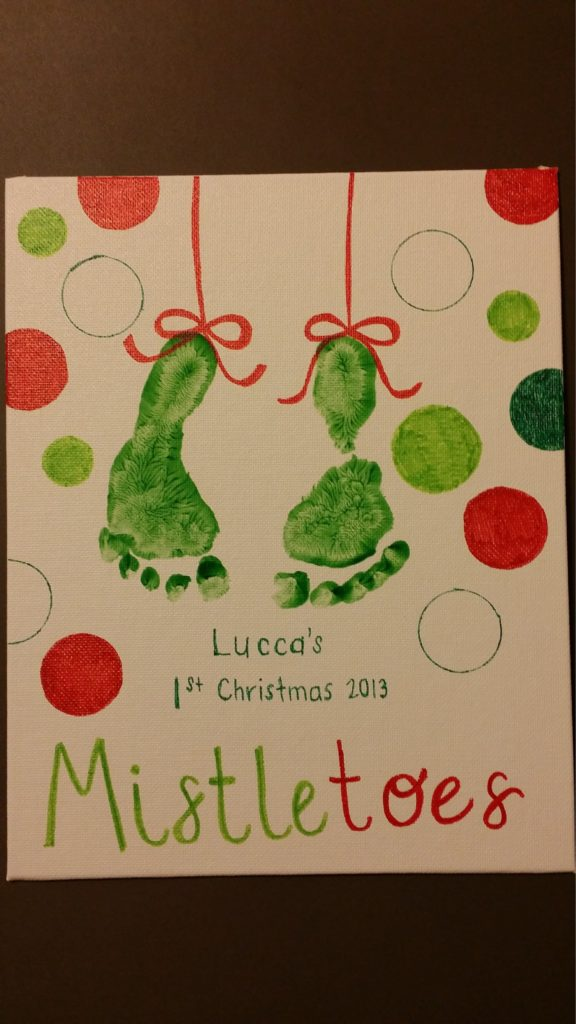 Christmas craft with baby footprints.