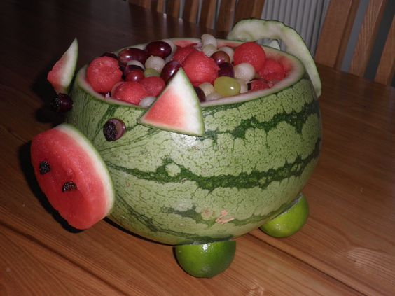 """Watermelon \""""pig\"""" filled with fruit mix."""