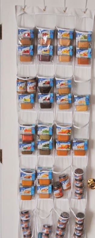 Shoe organizer used to store baby food packages.
